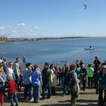 A crowd of onlookers gathers on the beach to watch the Rose Creek Duck Derby. Photo by San Diego EarthWorks.