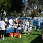 Volunteer painters line up to help paint the Rose Creek mural. Photo by San Diego EarthWorks.