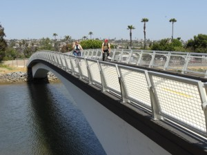 Bicyclists enjoying the Mike Gotch Memorial Bridge spanning Lower Rose Creek.