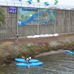 The mural is unveiled to event-goers and kayakers. Photo by RHS Photo.